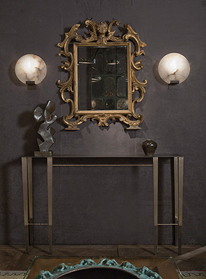 The second image highlights an 18th century Roman mirror flanked by 2 Moon Sconces by Stephen Downes over a console by Aurelien Gallet.  There is a bronze sculpture by Zigor and a small ceramic vase by Jean Girel.