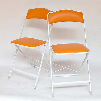 Stylish folding chairs in orange